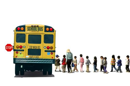 students lining up at bus