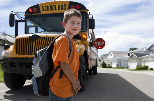 boy in front of bus